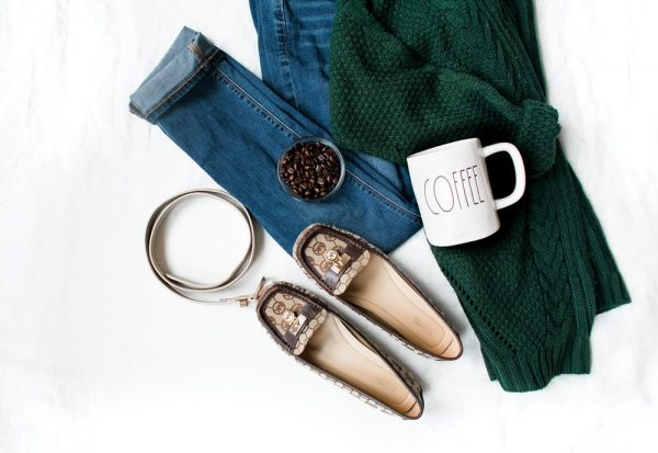 air of brown leather flats and white ceramic mug